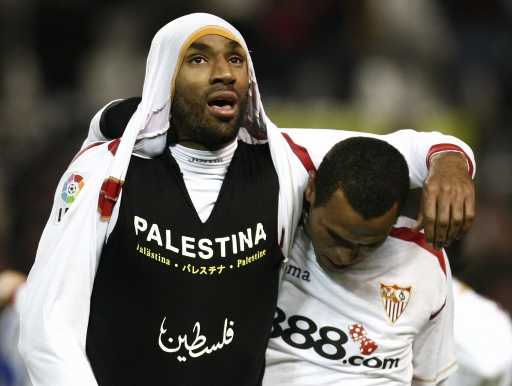 Sevilla's Kanoute celebrates next to Fabiano after scoring against Deportivo Coruna during their Spanish King's Cup soccer match in Seville